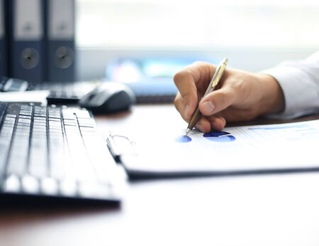 taking notes: Businessman taking business notes at office