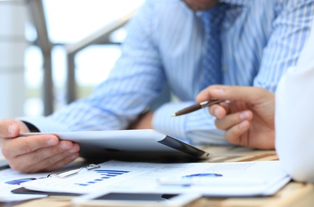 consultancy: Business adviser analyzing financial figures denoting the progress in the work of the company  Stock Photo