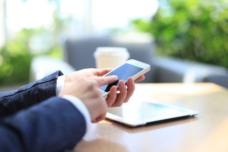 Modern workplace with digital tablet computer and mobile phone Standard-Bild