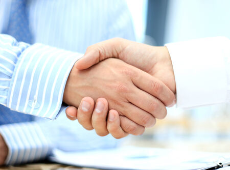 business handshake: Closeup of a business hand shake between two colleagues Stock Photo