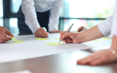 image: Image of business people hands working with papers at meeting