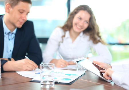 financial adviser: Business adviser analyzing financial figures denoting the progress in the work of the company