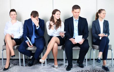 examination stress: Business people waiting for job interview. Five candidates competing for one position