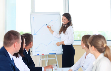 business conference presentation with team training flipchart office Stock Photo