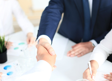customer: Business people shaking hands, finishing up a meeting Stock Photo