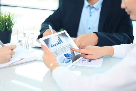 Business person analyzing financial statistics displayed on the tablet screen Stock fotó - 42437124