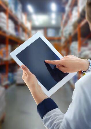 Businesswoman checking inventory in market on tablet computer Reklamní fotografie