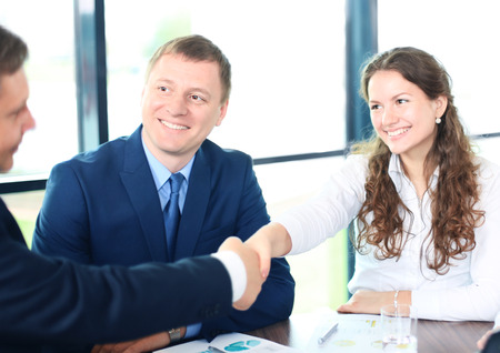 business support: Business people shaking hands, finishing up a meeting Stock Photo