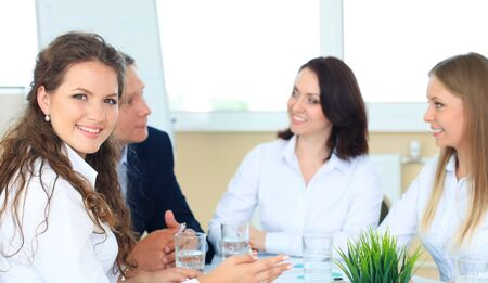 staff: business woman with her staff, people group in background at modern bright office indoors Stock Photo