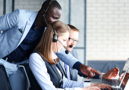 operator: Phone operator working at call centre office helping hiss colleague