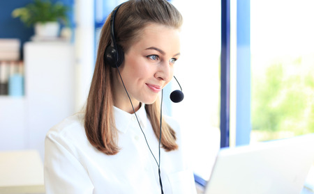 customer support: Female customer support operator with headset and smiling