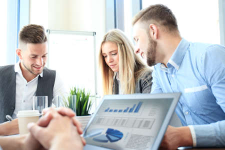 blurred people: Business team work process. Photo professional crew working with new startup project. Project managers meeting. Analyze business plans laptop. Stock Photo