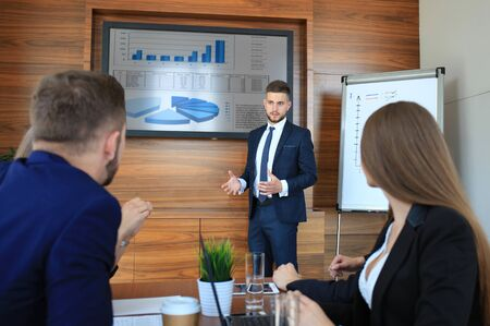 Business training at office, business man presenting successful financial numbers on screen of plasma TV at meeting room