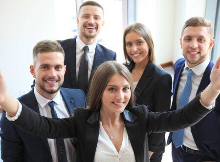 businesspeople: People taking selfie at business meeting
