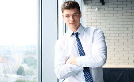 handsome young man: young handsome business man at the office Stock Photo