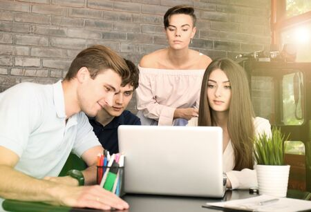 Group of young business people and designers.They working on new project.Startup concept. Stock Photo
