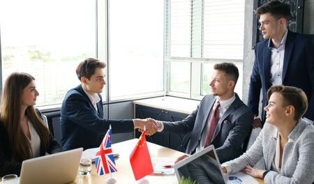 allies: United Kingdom and Chinese leaders shaking hands on a deal agreement.