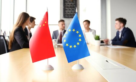 Diversity people talk the international conference partnership. Chinese flag and European union flag.