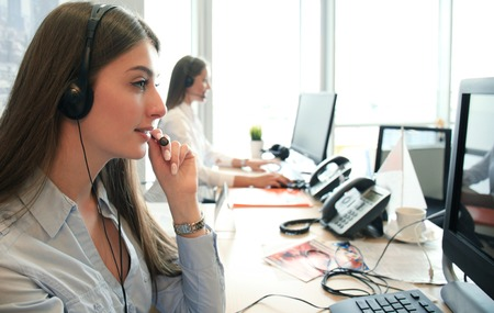 Attractive positive young businesspeople and colleagues in a call center office. Stock fotó