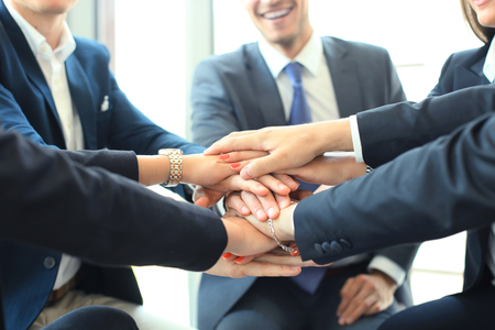 Group of businessman team touching hands together. Selective focus.
