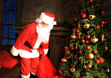 Santa Claus bring the sack with gifts for Christmas. Stock Photo