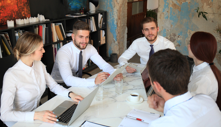 Top view of business people working together while spending time in the office