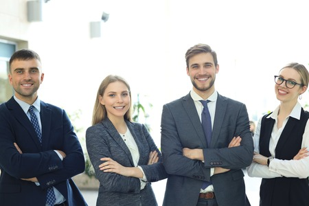 group of successful business people on the background of the office. Imagens