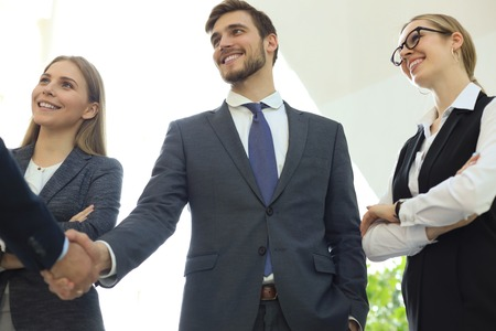 Business people shaking hands, finishing up a meeting. Imagens