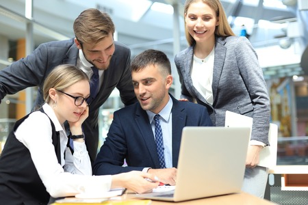 business team working on laptop to check the results of their work