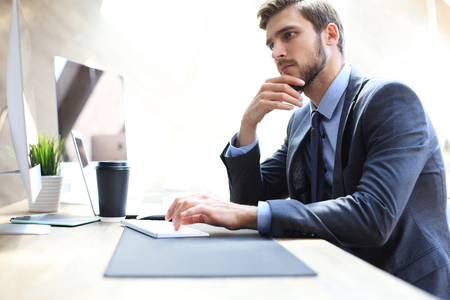 Modern businessman thinking about something while sitting in the office