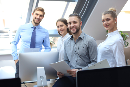 group of successful business people on the background of the office Imagens