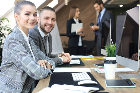 business woman with her staff, people group in background at modern bright office indoors Imagens