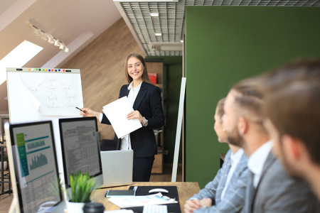 business conference presentation with team training flipchart office Imagens