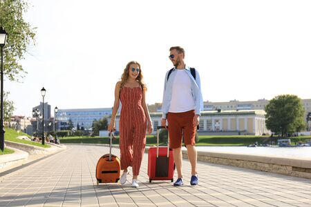 Summer holidays, tourism concept - smiling couple with luggage. Stock fotó