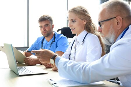 Team of modern doctors discussing the problems Stock Photo