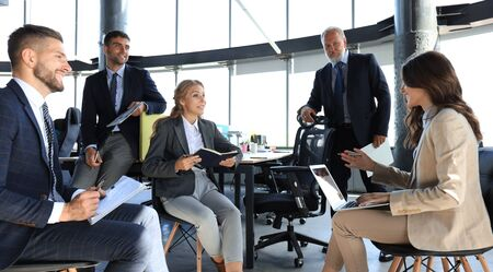 Business team discussing together business plans in office