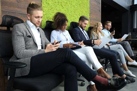 Modern business people waiting for job interview.