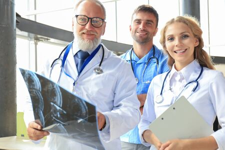 Group of doctors checking x-rays in a hospital Stock Photo