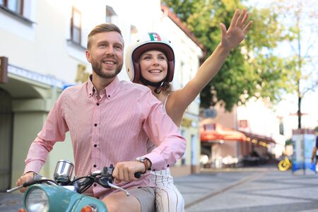 Young beautiful couple riding on motorbike. Adventure and vacations concept