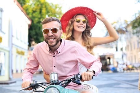Young couple in love riding a motorbike. Riders enjoying themselves on trip. Adventure and vacations concept Stock Photo