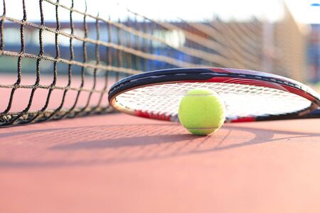 Tennis racket and the ball on tennis court