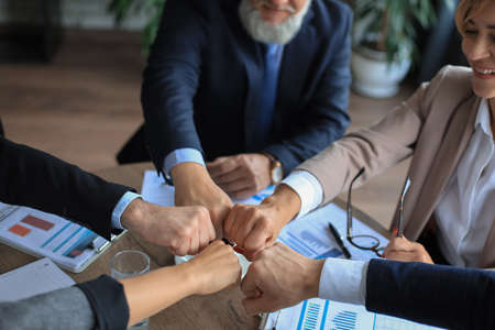 Business people teamwork stacking hand together concept