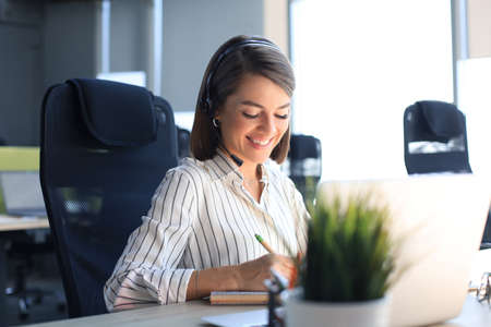 Female customer support operator with headset and smiling Reklamní fotografie
