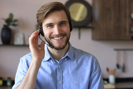 Male customer support operator with headset and smiling