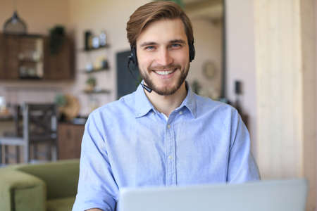 Freelance operator talking with headsets and consulting clients from home office