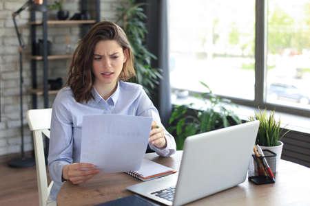 Happy entrepreneur woman sit at desk reading good news in post paper correspondence Standard-Bild