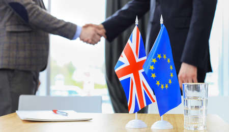 British flag and flag of European Union with businessman near by. Brexit