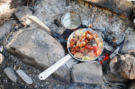 preparing cooking breakfast in camping at forest.