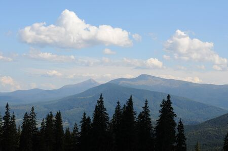 Summer landscape in mountains and the dark blue sky with clouds. Ukrainian Carpathian Mountains.