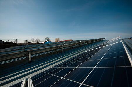 Solar panel against blue sky. Blue solar panels.